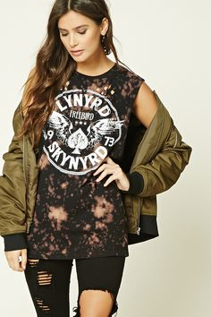 """A cotton muscle tee featuring a """"Lynyrd Skynyrd Freebird 1973"""" graphic on front, allover tie-dye print, distressed design, dropped raw-cut armholes, and a round neckline."""