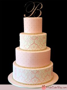 4 tier wedding cake is covered in blush pink fondant with white damask stencil and gold swiss dots and piped pearls. By The Pink Cake Box. So perfect, just a little less pink & more gold!