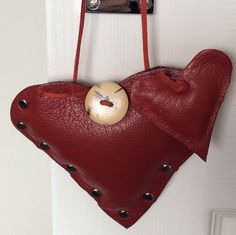 Pryle ..... A Pair of padded Hanging Hearts      Handmade leather hanging HEARTS     These will add a something to where ever you wish to hang them - over your dressing table mirror, door handles, wardrobe handles, photoframes, walls, etc.    They make lovely presents to give for a romantic celebration, best friends, mothers day, birthdays, anniversaries, love connections or simply to place in the home to add to a theme or accent colour.    Designed and hand made by Pryle in the UK they are…