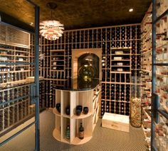 Glass vases and a chandelier make lovely additions to the wine cellar inquire at www.chicagolb.com