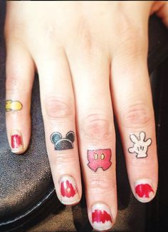 Mickey Mouse Fingers done by @BirdieTattoos at Black Rabbit Tattoo Studio in Port Moody, British Columbia.
