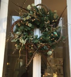 Pheasant feather Christmas wreath with gold and greenery