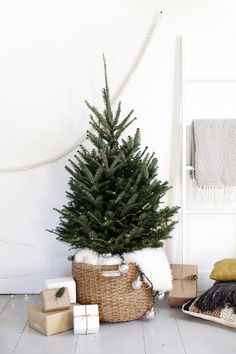 Incredibly Chic Modern Minimalist Christmas Trees If minimalist style is your thing, there are ways to make your holiday decorations reflect your sleek, modern decor. Try these Incredibly Chic Modern Minimalist Christmas Trees as inspiration (they're also Minimalist Christmas Tree, Scandinavian Christmas Trees, Small Christmas Trees, Beautiful Christmas Trees, Noel Christmas, Hygge Christmas, White Christmas, Holiday Tree, Christmas Tree Basket Skirt