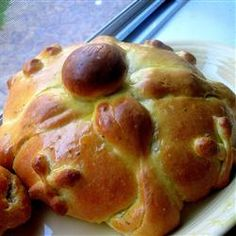 Pan de muertos (Spanish for Bread of the dead) is a type of sweet roll traditionally baked in Mexico during the weeks leading up to the Día de los Muertos, which is celebrated on November 1 and 2. It is a sweetened soft bread shaped like a bun, often decorated with bone-like pieces.
