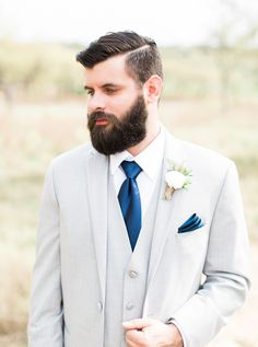 Gray suit + royal blue tie: http://www.stylemepretty.com/texas-weddings/2016/07/07/a-blanket-of-bluebonnets-made-for-the-ultimate-hill-country-wedding/ | Photography: Loft Photography - http://www.loftphotography.com/