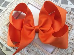 This item is unavailable - Frocks And Bows - This item is unavailable Excited to share this item from my shop: Hair Bows Boutique Hair Bows Large Hair Bow Girls Hair Bows Hair Bow Big Hair bows Big Hair Bow Big Bows Orange Hair Bows Huge Uniform Bow - Retro Hairstyles, Everyday Hairstyles, Girl Hairstyles, Large Hair Bows, Big Bows, Boutique Hair Bows, Fall Hair, Grosgrain Ribbon, Girl Gifts