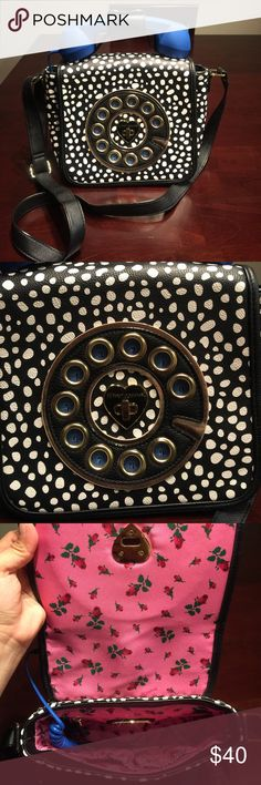 Cute Betsey Johnson phone purse black and white This item is in brand new condition I bought at Macy's it has a strap to hang on shoulders the strap is adjustable. The inside is beautiful hot pink and flowers. If you have any question please ask. Don't be shy to make me offers!! Betsey Johnson Bags Shoulder Bags