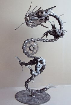 Wonderful sculpture of an Asian dragon in found materials.