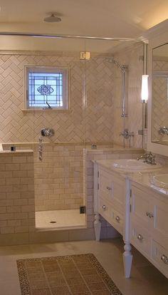 shower half walls, window in shower, sinks against half wall, tile at sink backsplash continues