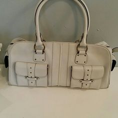 Nordstrom Shoulder Bag Super roomy bag for the gal who carries everything with her!  I can fit my tablet, make up, phone and still have room to throw in a pair of shorts!  Its off white matte eith antique brass hardware..Great condition.  Inside perfect. Minor wear on underside of handle. It's a great bag. 16w x 8t x 6.5 deep. Nordstrom  Bags Shoulder Bags