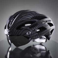 """The Dux Helm Premium in Carbon Silver is the world's first cycling helmet with """"True"""" Retractable Lens System, where the lens hides within the helmet frame. Lens System allows for quick and convenient lens replacement and can accommodate any we. Cycling Helmet, Bicycle Helmet, Bike Helmets, Bike Gadgets, Bicycle Accessories, First World, Lens, Silver, Bike Stuff"""