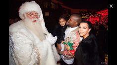 Kim, Kanye and North with Santa