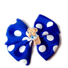 Duffy Bow by Magic Main Street Handmade hair bow with a Duffy charm. The bow is attached to an alligator clip.