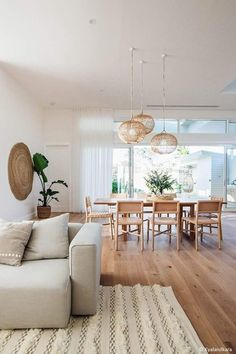 Love the open airy space in this dining room living room area.  Beautiful for a simplistic minimalist bohemian style home.