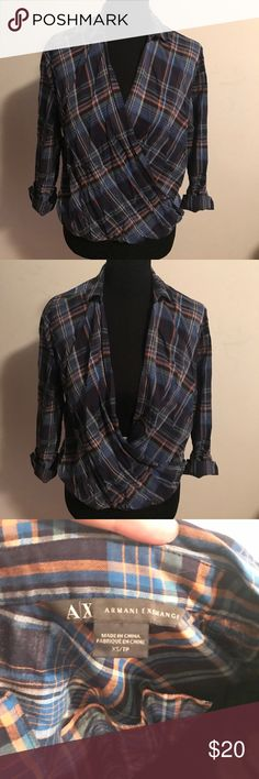 Armani Exchange Collared shirt with wrap front XS Shirt can be closed higher or lower. Button cuffed sleeve details. Size XS but can fit Size S as well. Made for roomy fit. Cute over jeans or a skirt. Can be Styled under a sweater as well. A/X Armani Exchange Tops Button Down Shirts