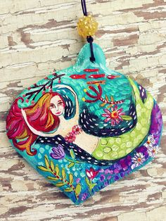 Hand painted 3x4 inch wood ornament. The back can be personalized.