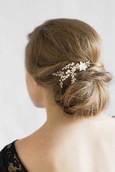 For the bride who wants to forgo the tiara for a look that's more understated, the Yves pearl bridal comb is infused with botanical, feminine details.