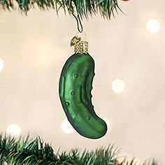 Old World Christmas Pickle Glass Blown Ornament Long ago when parents decorated the Christmas tree they hung the pickle ornament last, hiding it in the green Christmas Pickle Tradition, Christmas Pickle Ornament, Blown Glass Christmas Ornaments, Hand Painted Ornaments, Christmas Gift Box, Holiday Tree, Christmas Tree Ornaments, Christmas Ideas, Christmas Crafts