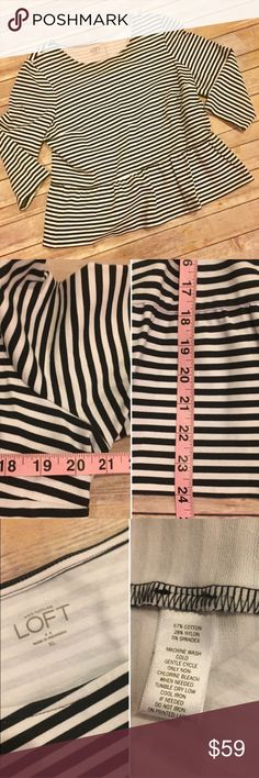 XL LOFT Striped Peplum Top Super cute black and white striped peplum top from LOFT. In great condition. Pictures DO NOT do this piece justice. Measurements of bust and length laying flat pictured, as is fabric content. Pair with a statement necklace, a skirt and heels or boots for a festive look! LOFT Tops