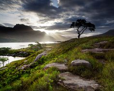 Loch Maree - a loch in Wester Ross in the northwest Highlands of Scotland. It was a sacred area to the early Celtics with Isle Maree, the sacred island of the Moon goddess in the lake and the sacred mountain Slioch near the shore.   by Stuart Low Photography