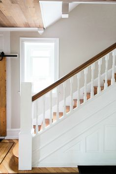 Victorian farmhouse staircase design.  The wood ceiling & barn door add farmhouse charm while the inlay floors and staircase woodwork stay true to the Victorian character <3