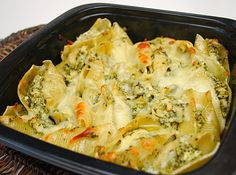 * To make ahead/freezer meals - Prepare as directed but place filled shells in an oven- and freezer-proof baking dish. Top with remaining 1/4 cup of cheese over filled shells, cover and freeze. When ready to prepare, defrost. Preheat oven to 350 degrees and bake shells uncovered for 35-40 minutes or until shells are bubbling hot and cheese