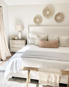 farmhouse master bedroom decor, neutral bedroom decor with wall baskets artwork and rustic bench, upholstered headboard with white bedding, cottage bedroom decor Cottage Bedroom Decor, Neutral Bedroom Decor, Modern Bedroom Design, Home Bedroom, Bedroom Designs, Grown Up Bedroom, Master Bedroom, Bright Bedroom Ideas, Cozy White Bedroom