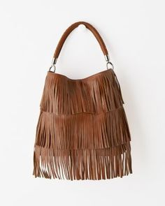 Live life on the fringe — the refined fringe, that is. Our on-trend leather bag, made for us in the hills of Italy, has just the right slouch factor and a flurry of sophisticated fringe so you'll sway with every step.
