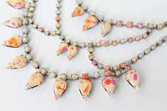 Give vintage rhinestone necklaces and costume jewelry a facelift by painting them with enamel or nail polish.