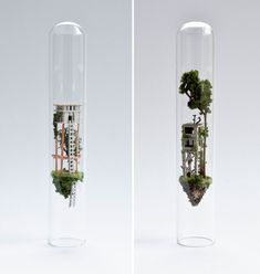 Small projects can be just as mind-blowing as those of a grander scale. That's what we've learned from Rosa de Jong, a Dutch artist who created a series of miniature floating cities fixed inside the tiny glass test tubes. Mini Mundo, Tiny World, Dutch Artists, Cartoon Drawings, Contemporary Art, Glass Vase, Sculpture, Bottle, Create
