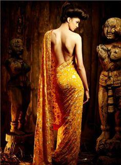 golden yellow saree. gorgeous print. good for nikka... hmmm...