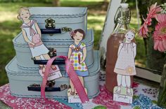Lily & Thistle Paper Dolls. We bought these for the little girl we support oversees. So cute!