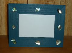 Paua Photo Frame.  A plain wooden photo frame painted with acrylic paints and paua pieces glued in place.  Lovely gift