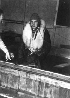 Dachau, Germany, A prisoner wearing flying equipment during a Hypothermia experiment in the camp.