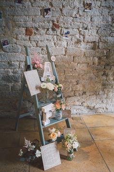 Ladder Decor Signs Flowers Pale Blue Peach Jars Light Pretty Summer Barn Wedding http://www.koweddings.com/