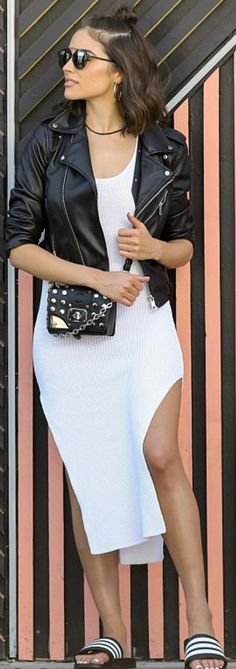 Who made Olivia Culpo's black leather jacket, sunglasses, white stripe sandals, and studded handbag?
