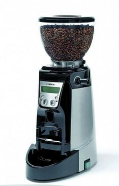 The Enea on Demand by Casadio is a great entry-level espresso grinder, with its 64 mm flat burrs and 2.65 lbs. bean hopper. The grinding process is all handled through the push button display, giving you complete control over how fine or coarse you want your coffee to be and the time of your shots. Removing the bean hopper is easy and safe, as the grinder automatically shuts off when you unscrew the micro-switch.