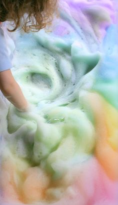 Recipe for fun and fluffy Rainbow Soap Foam for open-ended Sensory Play from Fun at Home with Kids. Learn colors
