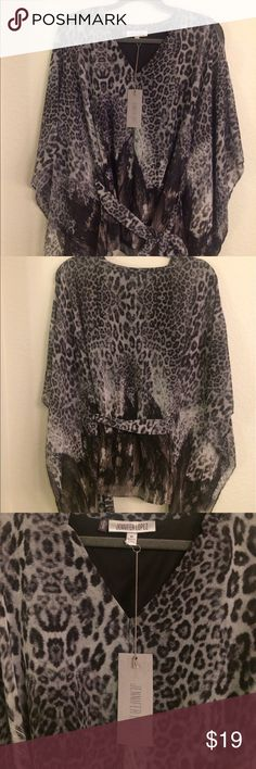 NWT Jennifer Lopez Top New With Tags Jennifer Lopez Top in cheetah print• Never been worn because there is a snag in the fabric near neckline. I do not know how to alter or sew, but someone who does can adjust the fabric (see 4th photo)• Can be tied around the waist with matching fabric belt• Has a black slip attached underneath-                          NO TRADES-NO HOLDS-NO RETURNS- Jennifer Lopez Tops Blouses