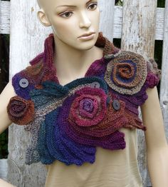 Crochet Scarf - Capelet. Unique scarf made Freeform method. Warm and pleasant to the touch. Beautiful unique design. Color: schadows purple,brown,navy blue,greenn One of a kind lenght about 106/25 cm 41,73/9,84 Size: One size fits all materials used: 30%wool, 70%acrylic Care instruction: hand wash using warm water. Because of different monitors and screen resolutions, colors may look different on the screen than really.