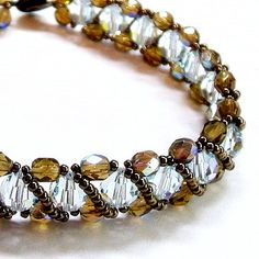 Ice blue bracelet woven with bronze crystals by toofancyjewelry, $58.00