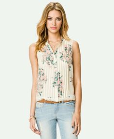 Brown shade of trousers with this top and a light pink colored blazer over would make a great work outfit