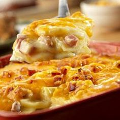 Country Scalloped Potatoes Recipe Main Dishes, Side Dishes with Campbell's Condensed Cream of Celery Soup, gravy, milk, baking potatoes, onion, cooked ham, shredded cheddar cheese