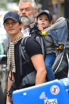 Is there anything cuter than a baby in a bag? Perhaps a father-son twin day! Orlando Bloom was seen toting his son Flynn around New York Cit...