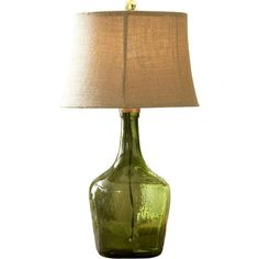 Featuring a jug-shaped green glass body topped with a linen shade, this table lamp offers a touch of homespun charm to your console or writing desk....