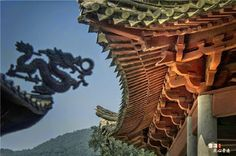 A dragon figure on a Chinese roof as a protective and decorative element