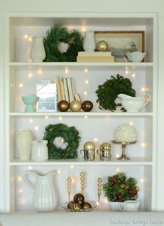 Love the lights behind all the decor..could maybe do the same thing since I have a shelf like this one in my room..