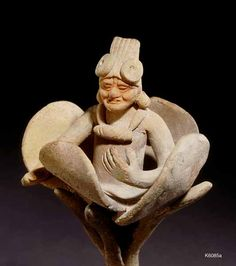Jaina. clay. height 15.1 cm. Close-up. Old god emerging from flower.