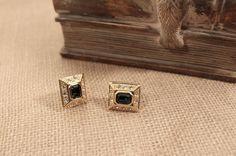 Roman brand gold tone pierced earrings  with a blue by FrogTears
