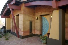 Rammed Earth construction by Edwards Design Group. Love it!